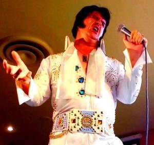 Matt Birse as Elvis is backed by All the King's Men.